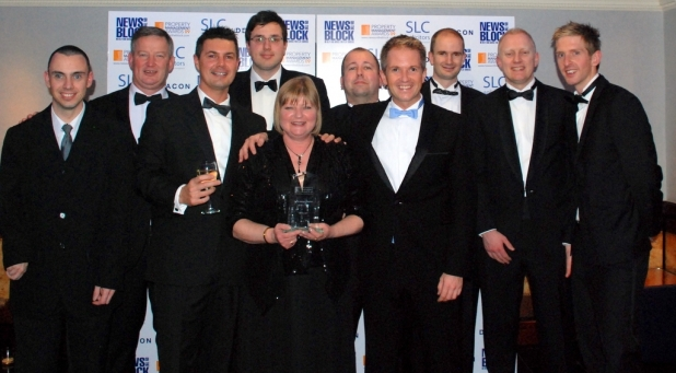 Isy celebrates with other members of the Encore team